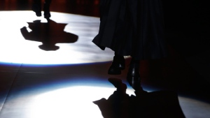 Models cast their shadows on the catwalk during the Dsquared2 men's Fall-Winter 2016-2017 show collection on Jan. 19, 2016. (Luca Bruno / AP)