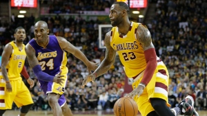 Cleveland Cavaliers' LeBron James (23) drives against Los Angeles Lakers' Kobe Bryant (24) in the second half of an NBA basketball game Wednesday, Feb. 10, 2016, in Cleveland. The Cavaliers won 120-111. (AP Photo / Tony Dejak)