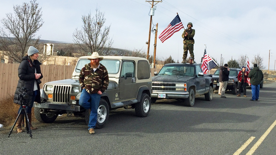 People protesting the FBI action and in support of the armed occupiers of the Malheur National Wildlife Refuge stand outside a roadblock near Burns, Ore., Thursday, Feb. 11, 2016. (AP / Rebecca Boone)