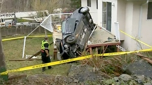 Car careens off road onto back deck