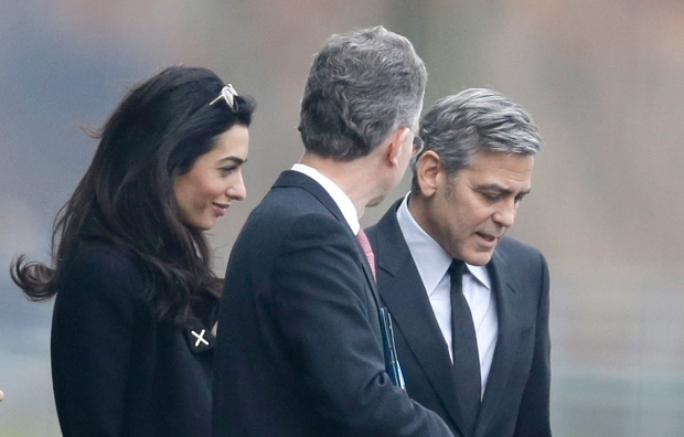 George Clooney, right, and his wife Amal Clooney