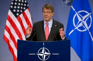 U.S. Secretary of Defense Ash Carter speaks during a media conference at NATO headquarters in Brussels on Thursday, Feb. 11, 2016. (AP Photo/Virginia Mayo)