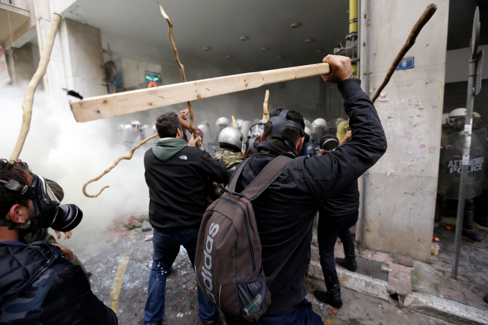 Farmers clash with riot police during a protest outside Agriculture ministry in Athens, Friday, Feb. 12, 2016. (AP Photo/Thanassis Stavrakis)
