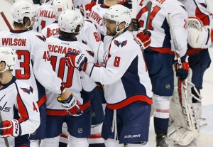 Washington Capitals' Alex Ovechkin (8)  goes through the celebration line after the Capitals beat the Minnesota Wild 4-3 in an NHL hockey game, Thursday, Feb. 11, 2016, in St. Paul, Minn. (AP / Jim Mone)
