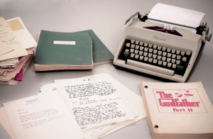 This 2015 photo provided by RR Auction shows Mario Puzo's 1965 Olympia typewriter with manuscripts and versions of both Godfather I and II screenplays. (RR Auction via AP)