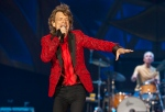In this July 4, 2015 file photo, Mick Jagger of the Rolling Stones performs at the Indianapolis Motor Speedway in Indianapolis, Ind. (Invision / Barry Brecheisen)