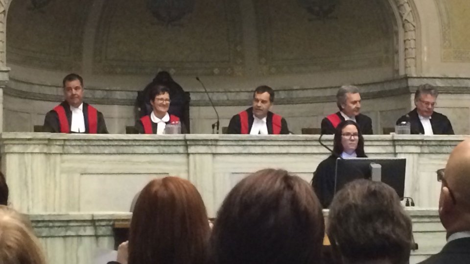 Kael McKenzie (left) is sworn in as a provincial judge in Manitoba at the law courts in Winnipeg on Feb. 12, 2016. Anne Krahn (second from left) was also sworn in, as associate chief judge.