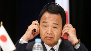 In this Oct. 27, 2014 file photo, Japan's Minister for Economic Revitalization Akira Amari listens to questions during a press conference at the Trans-Pacific Partnership meeting in Sydney, Australia. (AP Photo / Rob Griffith, File)
