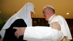 The head of the Russian Orthodox Church Patriarch Kirill, left, and Pope Francis meet at the Jose Marti airport in Havana, Cuba, Friday, Feb. 12, 2016. This is the first-ever papal meeting with the head of the Russian Orthodox Church, a historic development in the 1,000-year schism within Christianity. (Max Rossi / Pool photo via AP)