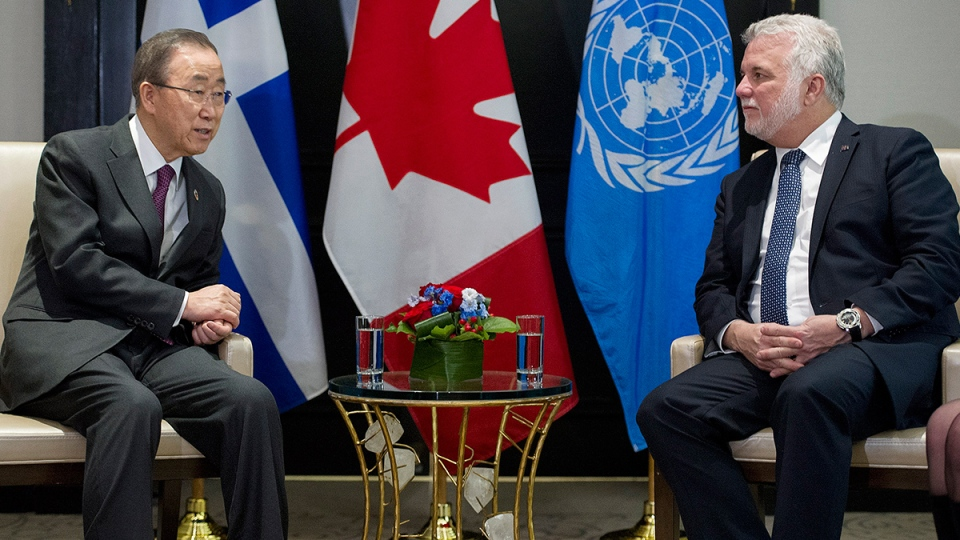 Quebec Premier Philippe Couillard, right, talks with United Nations Secretary General Ban Ki-moon during a meeting in Montreal, Friday, Feb. 12, 2016. (Graham Hughes / THE CANADIAN PRESS)