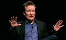 Television host Conan O'Brien gestures to the audience at Sanders Theatre on the campus of Harvard University in Cambridge on Friday, Feb. 12, 2016. (AP / Charles Krupa)