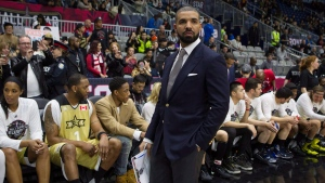 Drake stands in front of Team Canada's bench before the start of the NBA celebrity all-star game in Toronto on Friday February 12, 2016. (THE CANADIAN PRESS / Chris Young)