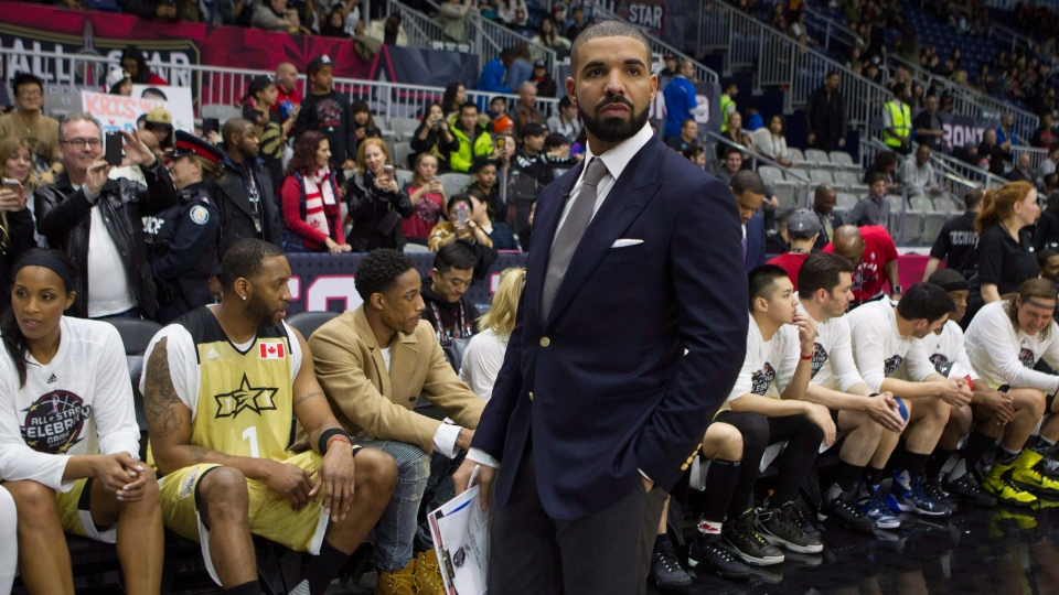 Drake stands in front of Team Canada's bench before the start of the NBA celebrity all-star game in Toronto on Friday, Feb. 12, 2016. (Chris Young / THE CANADIAN PRESS)