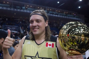 Team Canada's Win Butler, of Arcade Fire, holds the MVP trophy after his team defeated Team USA in the NBA celebrity all-star game in Toronto on Friday, Feb. 12, 2016. (The Canadian Press/Chris Young)