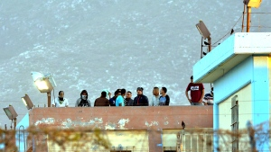 Inmates stand on the rooftop of the Topo Chico prison after a riot broke out around midnight, in Monterrey, Mexico, Thursday, Feb. 11, 2016. (AP / Emilio Vazquez)