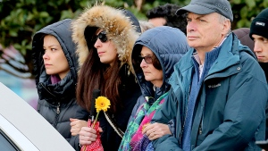 The family of Giulio Regeni - father Claudio, mother Paola and sister Irene - follows the coffin during his funeral service in Fiumicello, Northern Italy, Friday, Feb. 12, 2016. (AP / Paolo Giovannini)