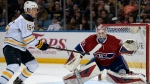 Buffalo Sabres center Jack Eichel (15) chases a high shot as Montreal Canadiens goaltender Mike Condon (39) watches the puck during the third period of an NHL hockey game, Friday, Feb. 12, 2016 in Buffalo, N.Y. Buffalo won 6-4. (AP Photo / Gary Wiepert)