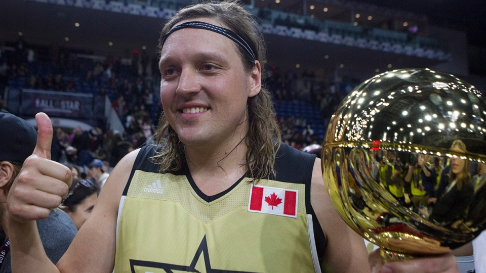 Team Canada's Win Butler of Arcade Fire, holds the MVP trophy after his team defeated Team USA in the NBA celebrity all-star game in Toronto on Friday, Feb. 12, 2016. (Chris Young / THE CANADIAN PRESS)