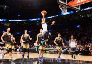 Team United States Zach LaVine slam dunks the ball past Team World players during second half NBA rising stars all-star basketball action in Toronto on Friday, February 12, 2016. (Mark Blinch/THE CANADIAN PRESS)
