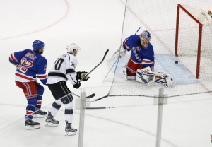 New York Rangers goalie Antti Raanta (32) looks back as the puck, shot by Los Angeles Kings left wing Tanner Pearson (70), rebounds out of the net after a goal, as Rangers defenseman Dan Boyle (22) watches during overtime of an NHL hockey game, Friday, Feb. 12, 2016, in New York. (AP/Julie Jacobson)