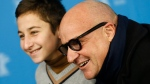 Protagonist Samuele Pucillu, left, and director Gianfranco Rosi pose for a photo during a photo call for the competition film 'Fire At Sea' at the 2016 Berlinale Film Festival in Berlin, Saturday, Feb. 13, 2016. (AP / Axel Schmidt)