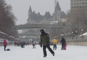 In this file photo, a man skates along the Rideau Canal, in Ottawa on Tuesday, Feb. 9, 2016. (Adrian Wyld/THE CANADIAN PRESS)
