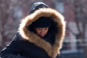 A woman bundles up against the cold air, Friday, Feb. 12, 2016, in New York. (AP/Mary Altaffer)
