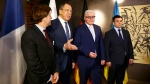 Political Director of the French Foreign Ministry Nicolas de Riviere, Russian Foreign Minister Sergey Lavrov, German Foreign Minister Frank-Walter Steinmeier and Ukrainian Foreign Minister Pavlo Klimkin, from left, pose for the media prior to their meeting at the Munich Security Conference in Munich, Germany, Saturday Feb. 13, 2016. (Michael Dalder /Pool Photo via AP)