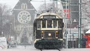 In this file photo, a tram cuts its way through snow covered streets in downtown Christchurch, New Zealand, Monday, June 12, 2006. (AP Photo / NZPA, Martin Hunter)