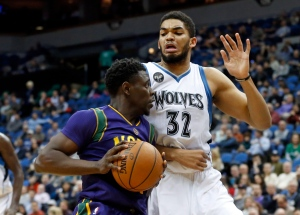 New Orleans Pelicans' Jrue Holiday, left, works his away around Minnesota Timberwolves' Karl-Anthony Towns in the second half of an NBA basketball game on Feb. 8, 2016, in Minneapolis. (Jim Mone / AP Photo)