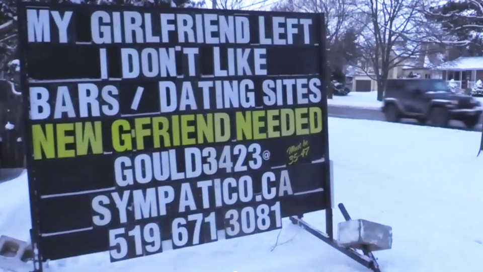 Peter Gould, 47, posted this sign in his London, Ont. front lawn in hopes of finding a new girlfriend.