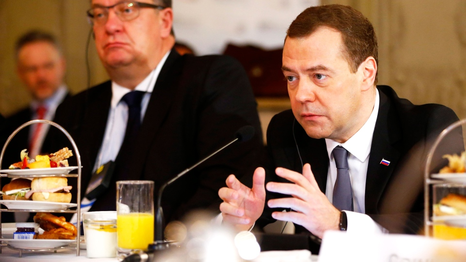 Russian Prime Minister Dmitry Medvedev, right, attends a breakfast with members of a German Economic delegation at the Security Conference in Munich, Germany, Saturday, Feb. 13, 2016 (AP / Matthias Schrader).