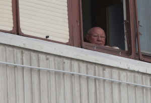 In this July 28, 2014, photo, Jakob Denzinger looks from his apartment window in Osijek, eastern Croatia. (AP/Darko Bandic)