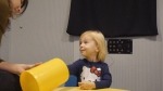 In this images from video provided by University of North Carolina at Chapel Hill, a toddler participates in a speech perception experiment in a laboratory at the University of North Carolina in Chapel Hill, N.C. (Emily Buss/University of North Carolina at Chapel Hill via AP)