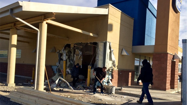 Thieves caused extensive damage when they crashed a front end loader into a Calgary Royal Bank branch.