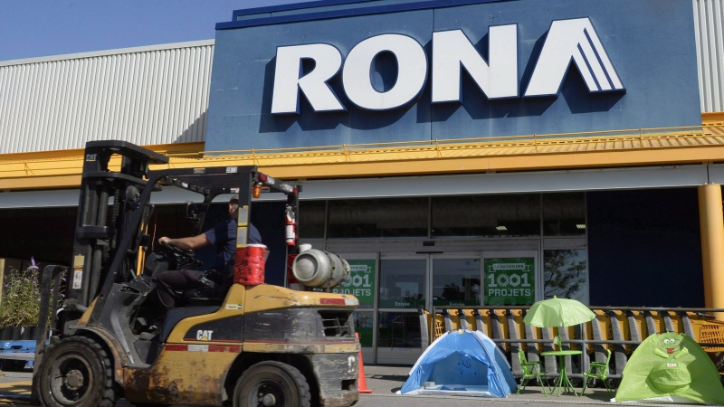 A man drives a forklift in front of a Rona home improvement store in St. Eustache, Que., just outside Montreal, on July 16, 2015. (Ryan Remiorz / The Canadian Press)