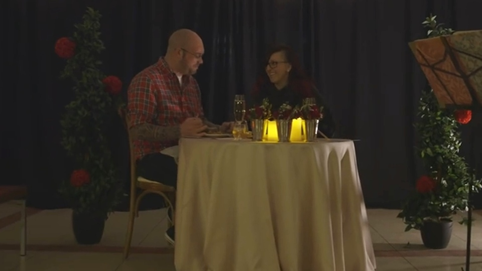 Gordon Lewis (left) and Vanessa Marshal are seen dining at the Hospital for Sick Children. (SickKids / YouTube)