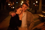 """This photo provided by Fox Searchlight shows, Saoirse Ronan, left, as Eilis Lacey and Emory Cohen as Tony, in a scene from the film, """"Brooklyn."""" (Kerry Brown/Fox Searchlight via AP)"""
