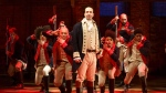 This image released by The Public Theater shows Lin-Manuel Miranda, foreground, with the cast during a performance of 'Hamilton,' in New York. (Joan Marcus)