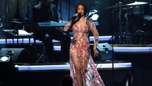 "Rihanna performs ""Say You Say Me"" at the MusiCares Person of the Year tribute honoring Lionel Richie at the Los Angeles Convention Center on Saturday, Feb. 13, 2016. (Photo by Chris Pizzello / Invision / AP)"
