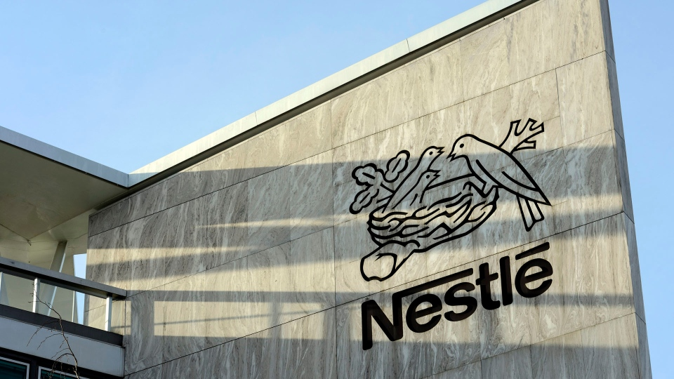 In this Feb. 14, 2013 file picture the Nestle logo is photographed at the Nestle headquarter in Vevey, Switzerland. (Laurent Gillieron/Keystone via AP)