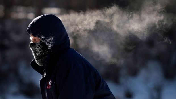 A skater's breath trails behind him as he skates on the Rideau Canal Skateway in Ottawa on Sunday, Feb. 14, 2016 as an extreme cold warning is in affect, with morning temperatures at -28C, feeling like -38C with the wind chill. (THE CANADIAN PRESS / Justin Tang)