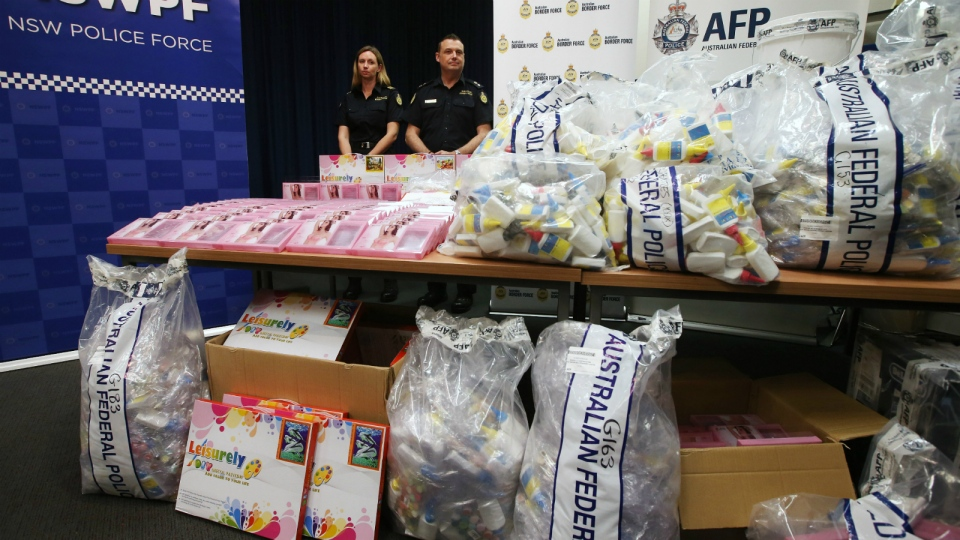 Officers stand by a display of confiscated drugs in Sydney on Monday, Jan. 15, 2016. (AP / Rick Rycroft)