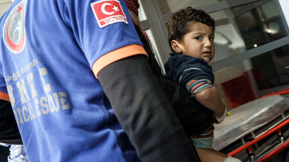 Turkish medics carry a wounded Syrian boy to a hospital in Kilis, Turkey, Monday, Feb. 15, 2016. (AP / Halit Onur Sandal)