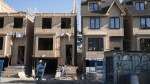 Houses are shown under construction in Toronto on Friday, June 26, 2015. THE CANADIAN PRESS/Graeme Roy