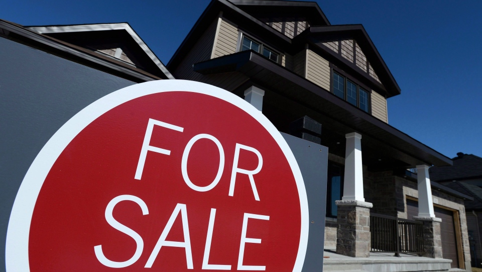 A sign advertises a new home for sale in Carleton Place, Ont., on March 17, 2015. New federal rules for Canadian mortgages have now gone into effect. The changes affect properties that cost more than $500,000 — a small percentage of the overall market. (THE CANADIAN PRESS / Sean Kilpatrick)