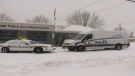 A man's body was found in this automotive shop shortly after a woman's body was found in a nearby apartment in London, Ont. on Friday, Feb. 12, 2016.