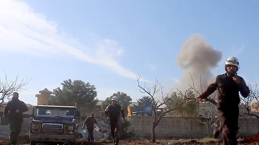 This image taken from video provided by the Syrian activist-based media group Maara Media Center shows Syrian Civil Defense rescuers running from the site of a second explosion near a hospital run by an international medical charity, also known by its French acronym MSF in Maaret al-Numan, Idlib, Syria, Monday, Feb. 15, 2016. (Maara Media Center)