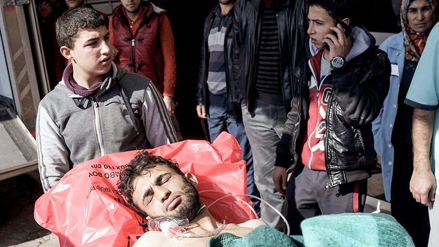 A wounded Syrian man is carried to a hospital in Kilis, Turkey, Monday, Feb. 15, 2016. (AP / Halit Onur Sandal)