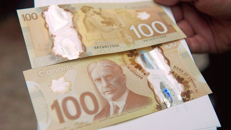 The $100 bill is shown in Toronto, on Monday Nov. 14, 2011. (THE CANADIAN PRESS/Nathan Denette)